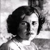 За то, что девушка Александра Столповская из села Белая Горка подобрала в поле раненого красноармейца. Расстреляна немцами.